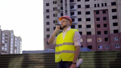 Young Builder Talks on His Phone