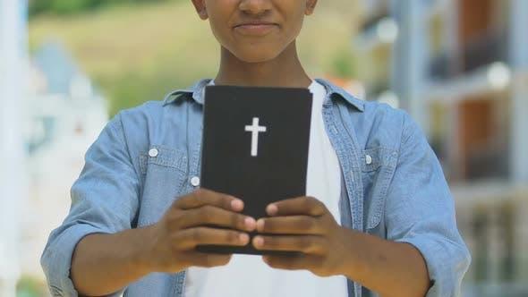 Thumbnail for Teen Boy Holding Bible, Spiritual Development
