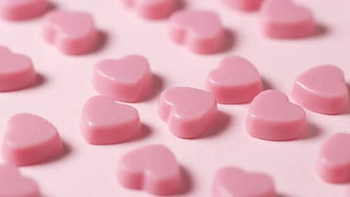 Pink chocolate candy on pink background