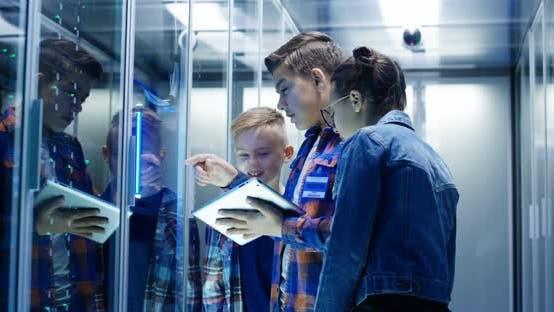 Kids with Digital Pad in Server Room