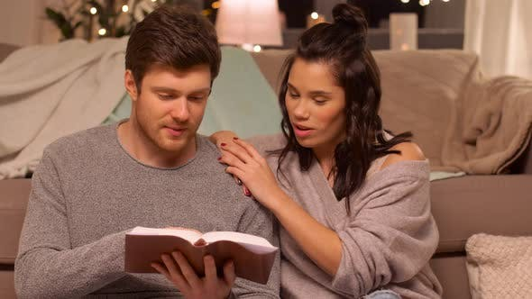 Cover Image for Happy Couple Reading Book at Home