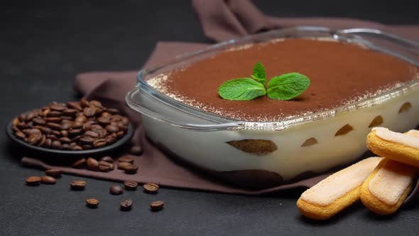 Thumbnail for Tiramisu Dessert in Glass Baking Dish and Savoiardi Cookies on Concrete Background