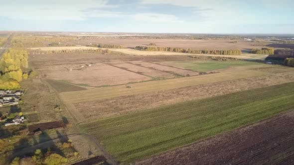 Thumbnail for Aerial Rural Landscape with Fields Among Forests in Autumn