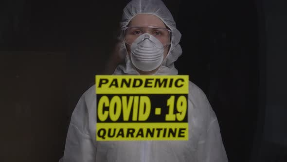 Woman in Protective Suit in Quarantine Zone. Coronovirus and Isolation Concept