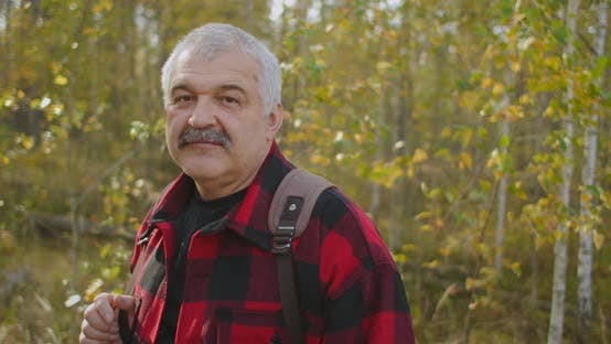 Thumbnail for Portrait of Grey-haired Tourist with Moustache in Forest at Autumn Day, Man Is Smiling To Camera
