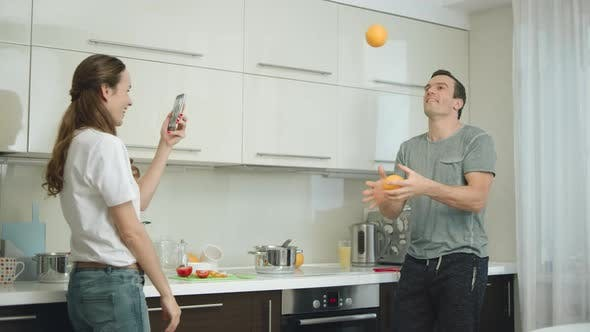 Thumbnail for Happy Couple Cooking Healthy Breakfast at Kitchen Together.
