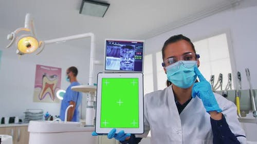 Pov Patient to Dentist Doctor Showing Tablet with Chroma Display
