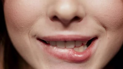 Playful Girl Biting Lip in Studio