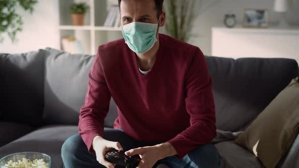 Thumbnail for Man playing video game on quarantine. Shot with RED helium camera in 8K.