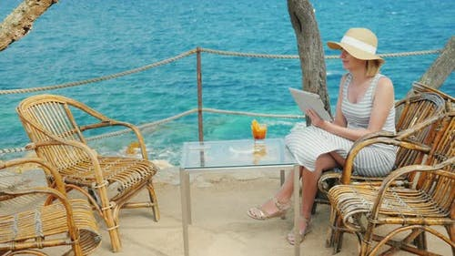 Woman Tourist Speaks with the Tablet, Always-on Connection. Videochat of Scenic Spot Overlooking the