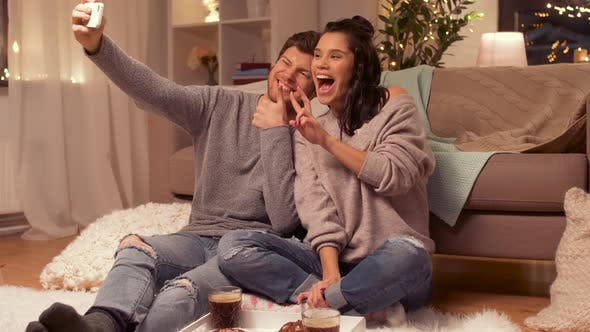 Thumbnail for Happy Couple Taking Selfie By Smartphone at Home