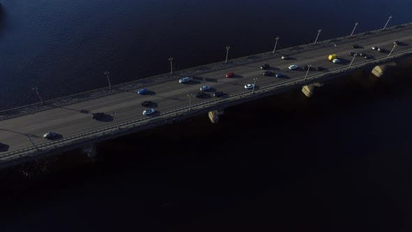 Thumbnail for Car Motion on Highway Bridge Over River. Drone View Car Driving on River Bridge