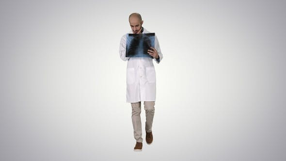 Cover Image for Doctor Radiologist Looking at X-Ray Scan Walking on Gradient