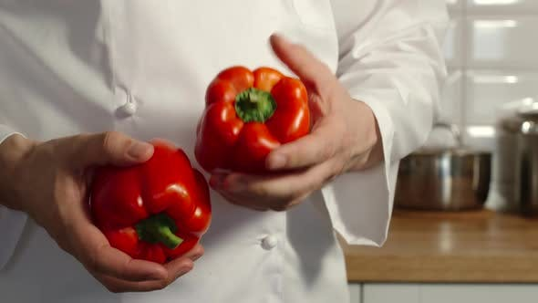 Thumbnail for Chief-Cooker Juggles A Red Pepper Bells In A Kitchen