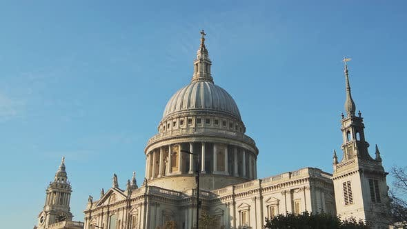 St Pauls Cathedral, a popular London tourist attraction and famous building on a bright blue sky day