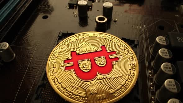 Thumbnail for Gold Bit Coin BTC Coins on the Motherboard