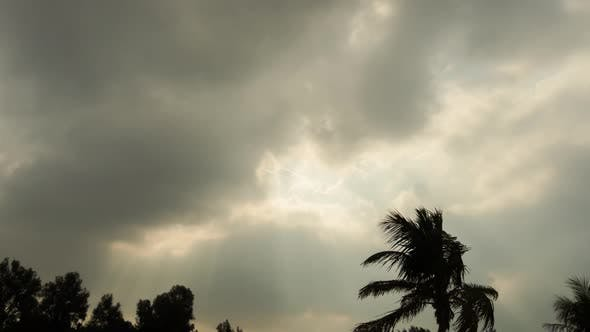 Thumbnail for Timelapse of Dark Clouds and Sun Rays
