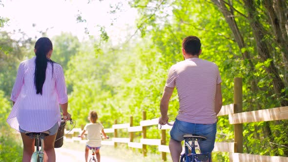 Thumbnail for Happy Family Riding Bicycles in Summer Park