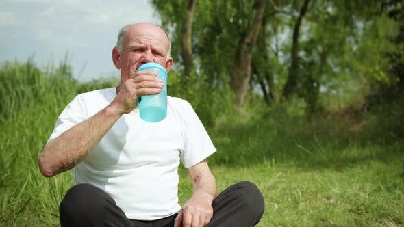 Thumbnail for Portrait of an Elderly Healthy Man Drinking Clean Healthy Cool Water After Playing Sports and