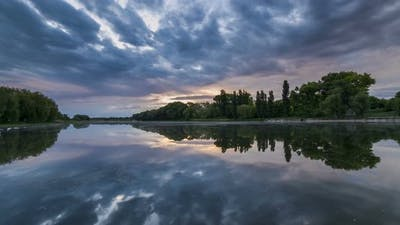 Timelapse of Beautiful Cloudy Sunrise in a Lake with Reflection