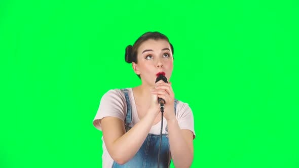 Thumbnail for Cute Girl Sings Into a Microphone and Moves To the Beat of Music, Slow Motion