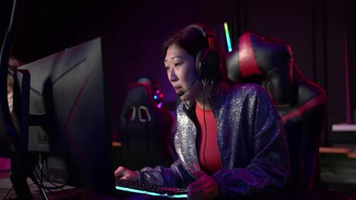 A Famous Girl Streamer Comments on a Live Match of Esports Teams on Online First Face Shooter