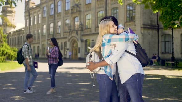 Thumbnail for Multiracial classmates embracing, happy to see each other after holidays