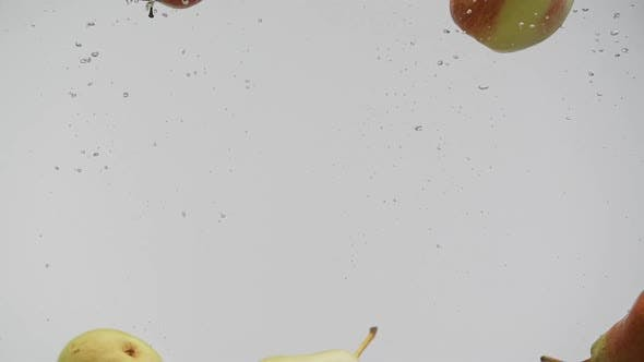 Thumbnail for Red and Yellow Pears and Apples Fruits Under Water with Splash and Air Bubbles White Background