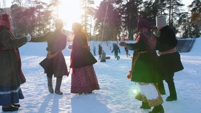 Russian Folk - Men and Women in Russian Folk Costumes Are Dancing in Pairs in a Winter Park