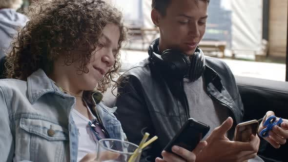 Thumbnail for Young Boys Browsing the Net on Smartphones