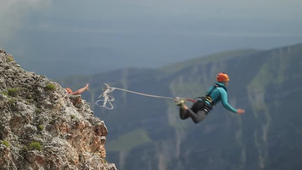 Thumbnail for Man Jumping Off a Cliff, Rope Jumping in the Mountains