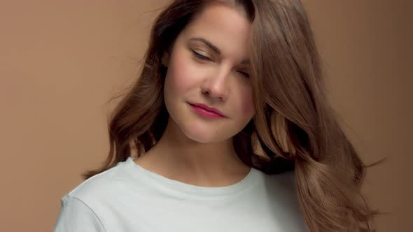 Thumbnail for Monochrome Natural Makeup Look Caucasian Woman in Studio with Brunette Wavy Hair Blowing