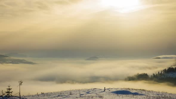 Foggy Morning in the Winter Mountains