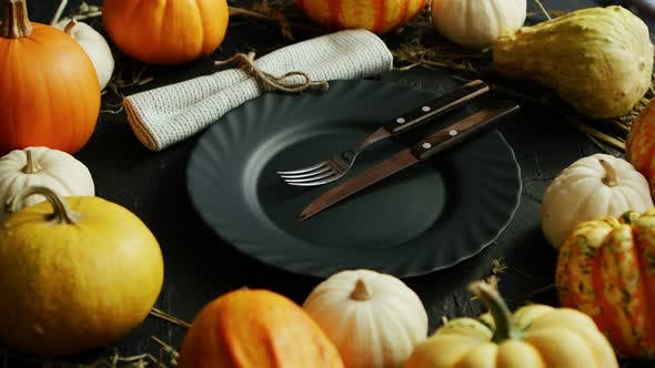 Thumbnail for Black Plate and Cutlery Surrounded By Pumpkins