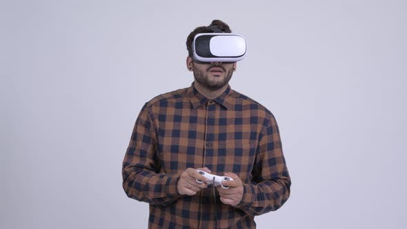 Thumbnail for Young Bearded Indian Hipster Man Playing Games and Using Virtual Reality Headset