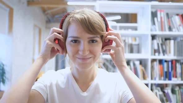 Thumbnail for Smiling Young Woman Wearing Headphones to Listen Music