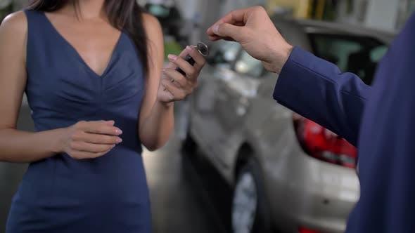 Thumbnail for Handing Over Car Keys at Automobile Dealership