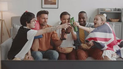 Friends Clinking Beer Bottles on Couch