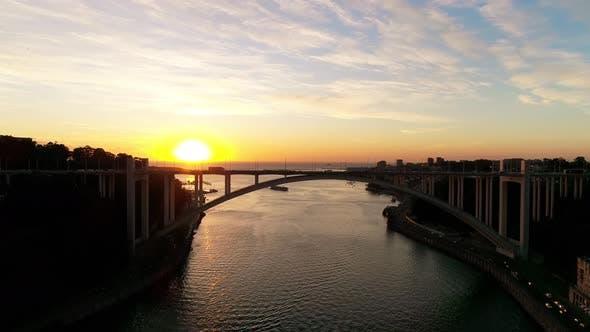 Thumbnail for Many Cars Passing on Bridge at Sunset