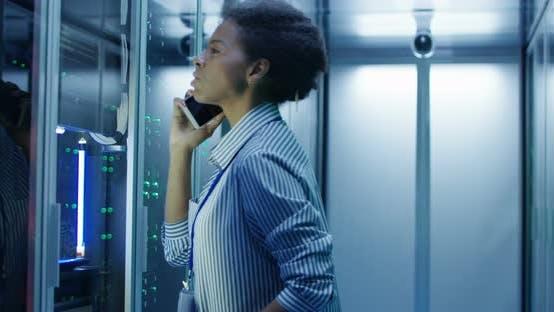 Thumbnail for Black Woman Speaking on Phone in Server Room