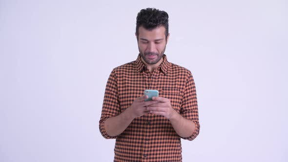 Thumbnail for Happy Bearded Persian Hipster Man Using Phone
