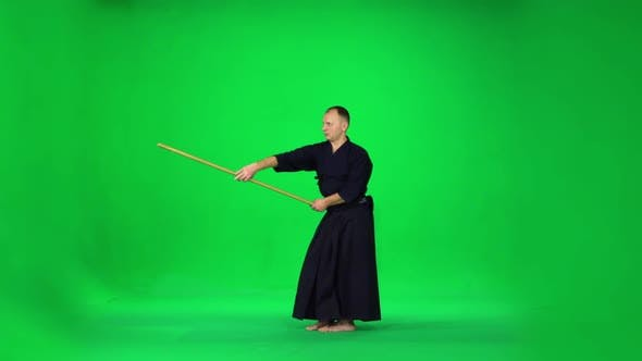 Thumbnail for Masculine Kendo Warrior Practicing Martial Art with the Bamboo Bokken on Green Screen, Slow Motion