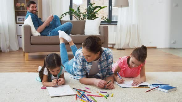 Mother with Little Daughters Drawing at Home 21
