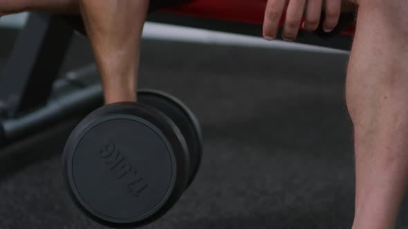 Man Training with Dumbbell during Gym Workout