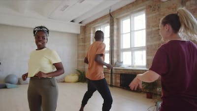Afro Couple Learning Dance with Female Teacher