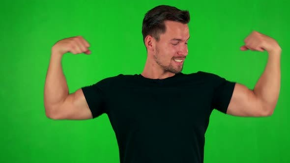 Thumbnail for Young Handsome Caucasian Man Does Poses with Muscles To Camera  - Green Screen