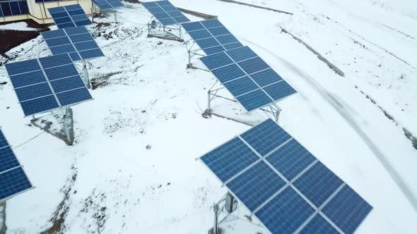 Thumbnail for Rows of Snow Covered Solar Panels