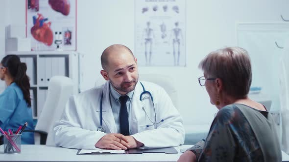 Thumbnail for Male Doctor Interviewing an Elderly Woman