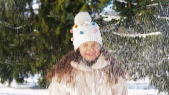 Thumbnail for Happy Little Girl Throwing Snow in Winter Park