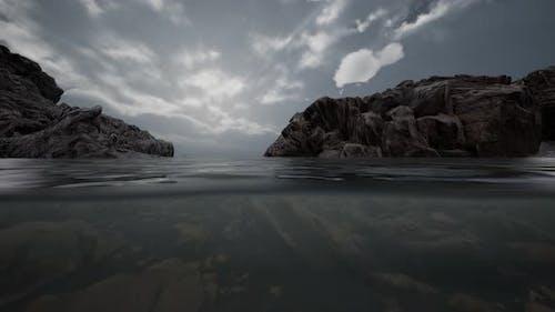 Half Underwater in Northern Sea with Rocks